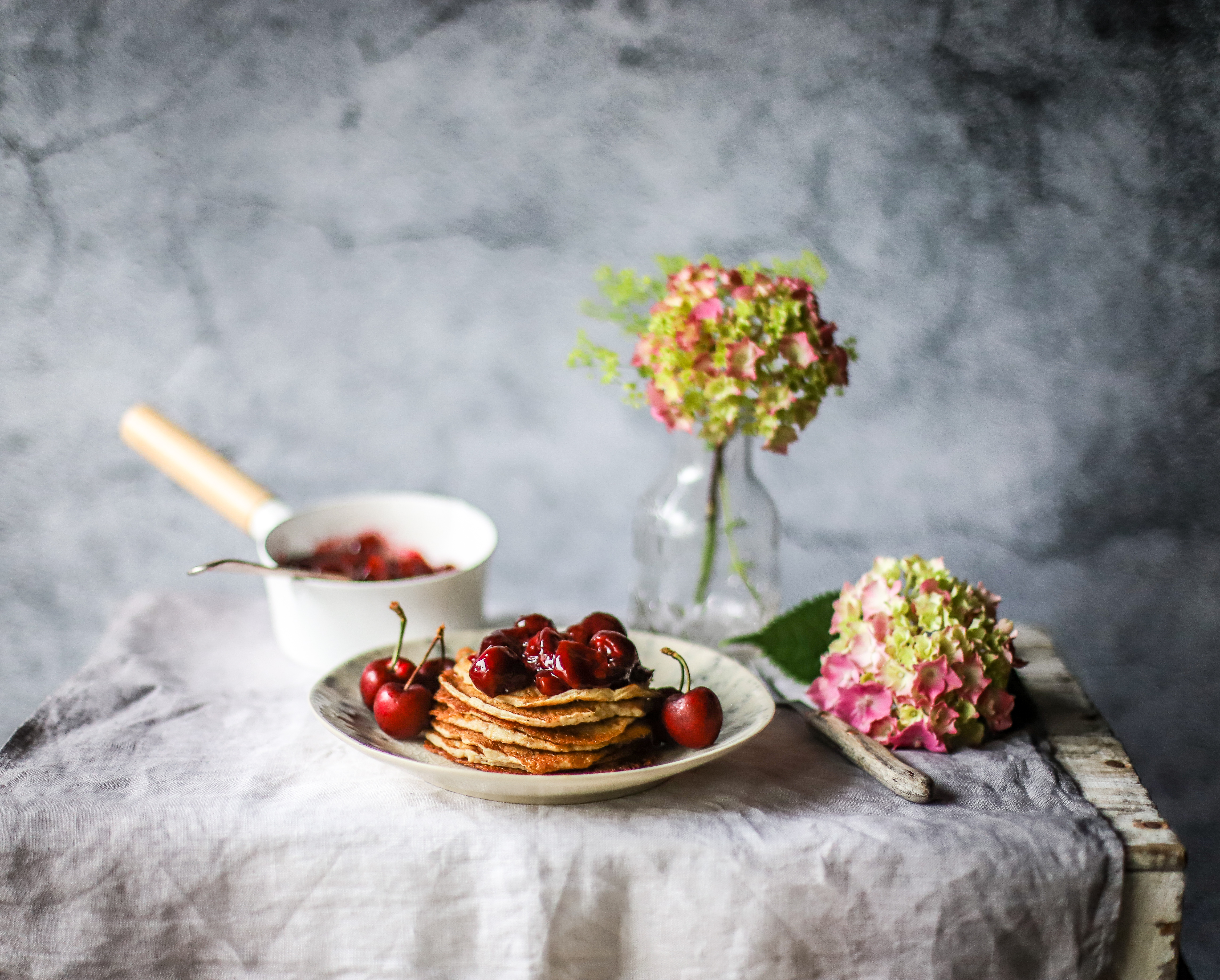 Make nutritious, gut-friendly probiotic pancakes with an easy fresh cherry sauce - that can double as a pie filling! - for a delicious weekend family breakfast or dessert. #breakfast #pancakes #oats #guthealth #cherries #kefir