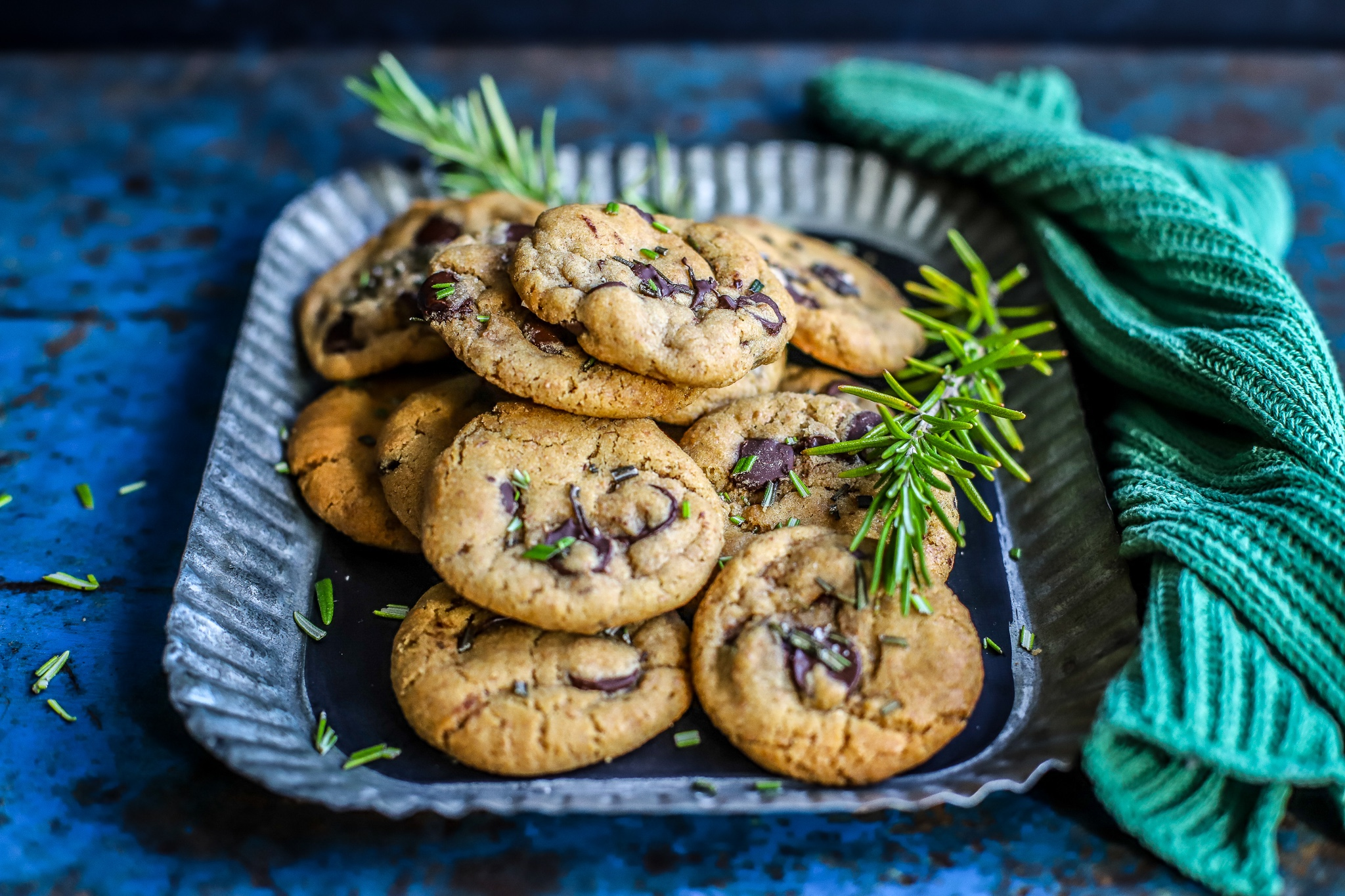chocolate chip cookies on metal tray with dark background