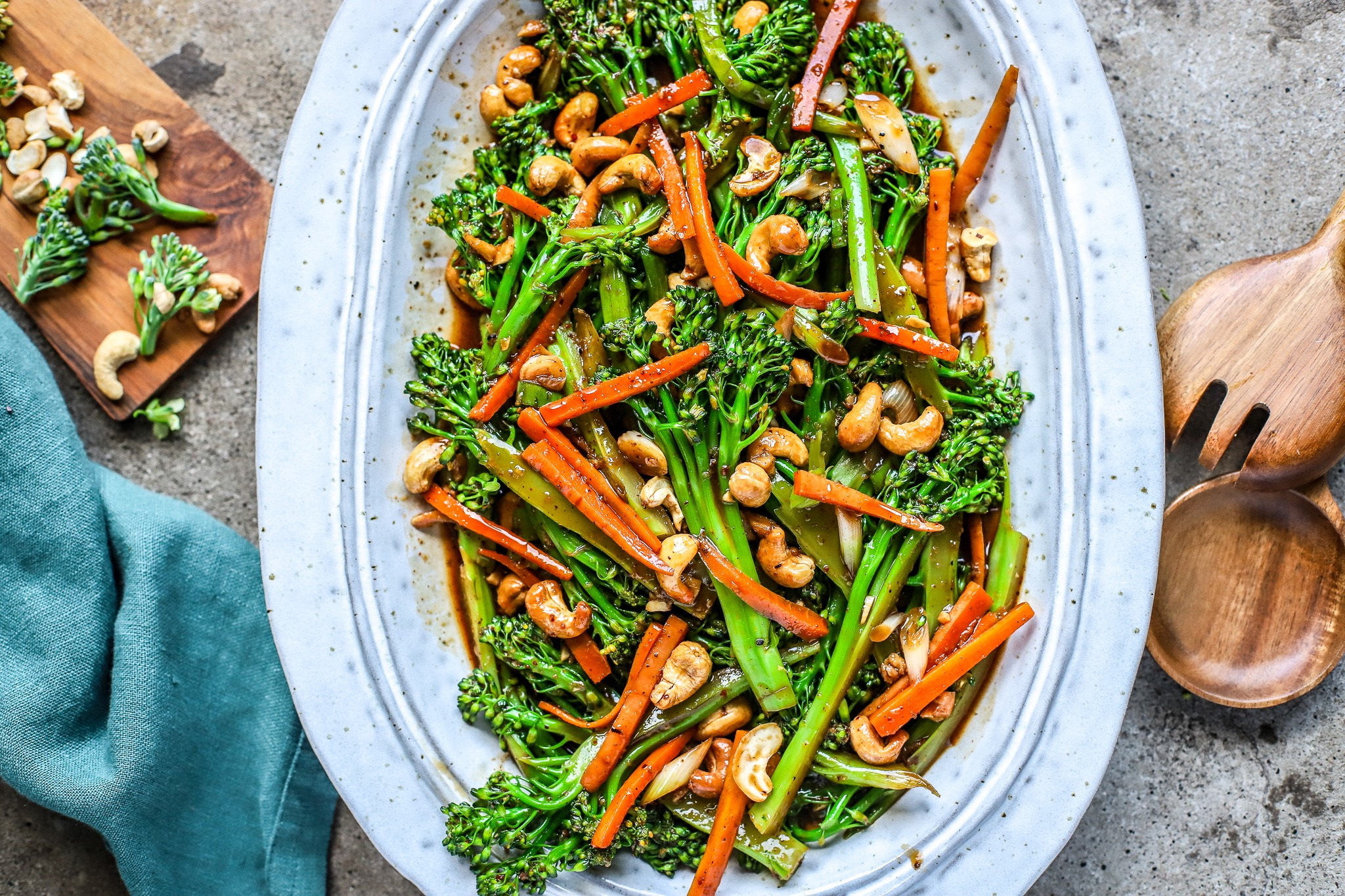 Feature image of Kung Pao style broccoli on handmade grey ceramic plate on concrete background