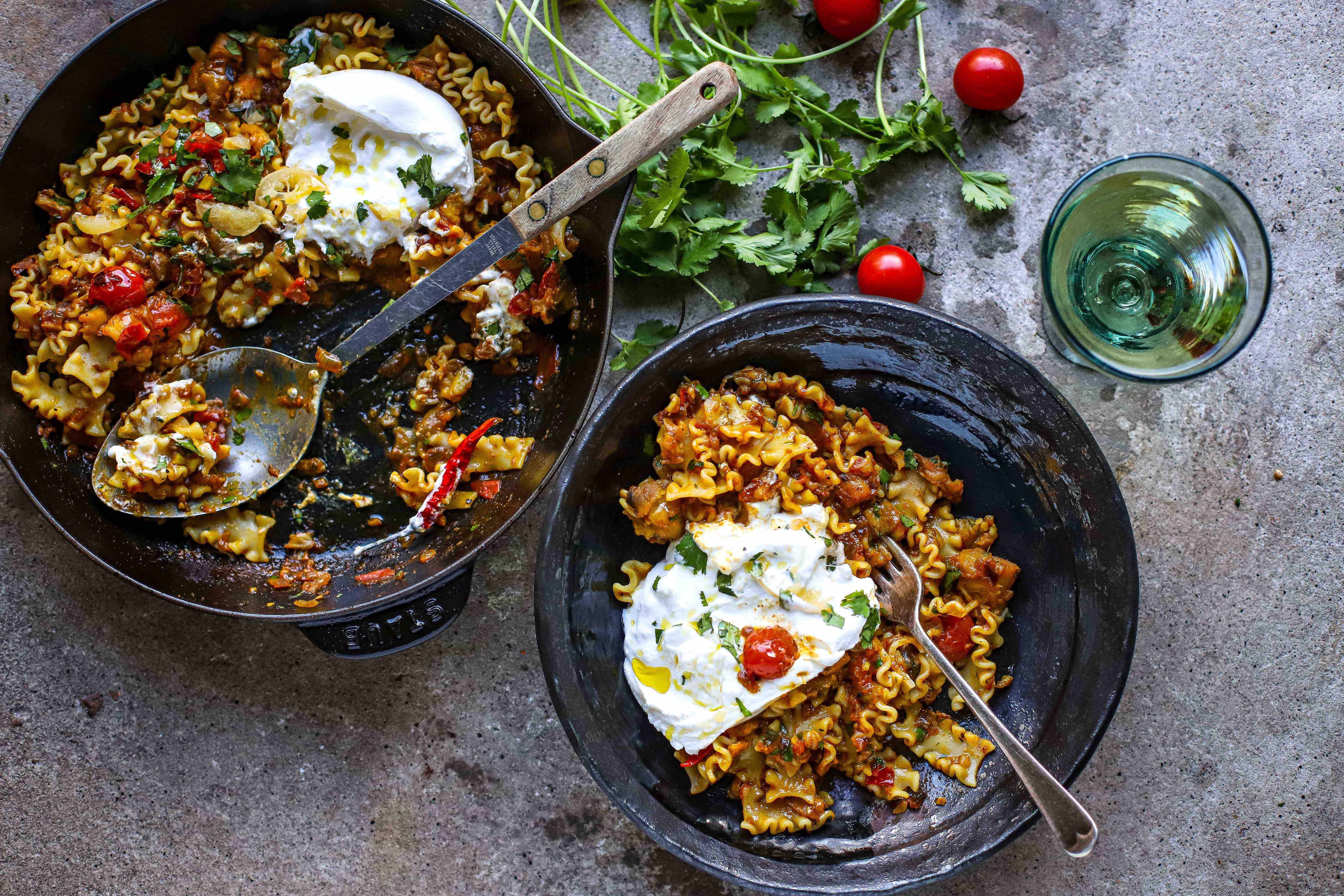 baingan bharta pasta with burrata in skillet and bowl